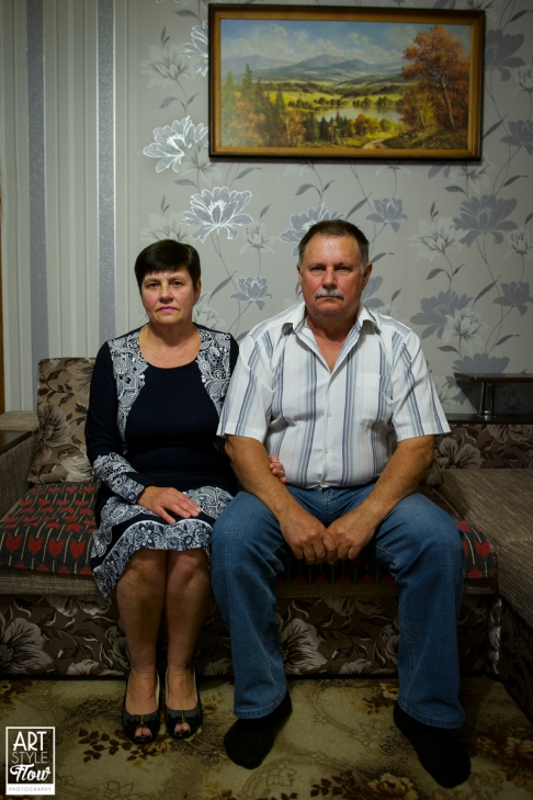 "Portait of a liquidator and is wife in ther very ""Ukrainian"" home."